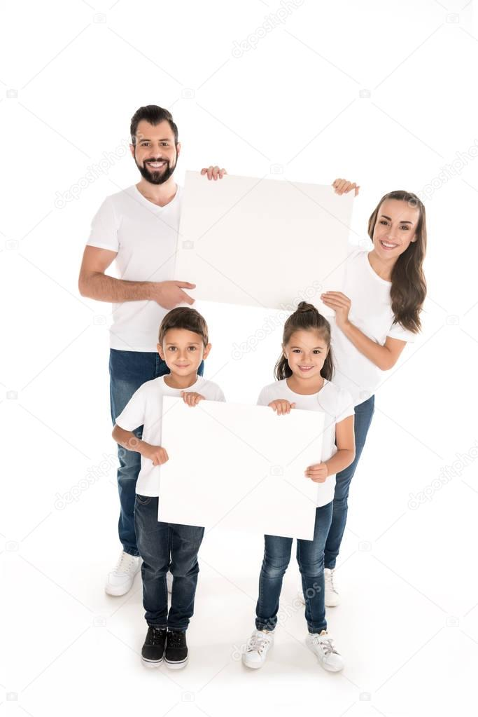 family with blank banners