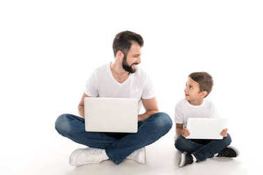 father and son with digital devices