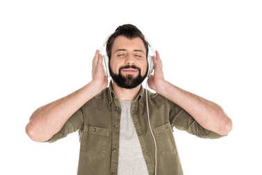 Bearded man with closed eyes listening music with headphones, isolated on white stock vector
