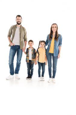 parents holding hands with schoolchildren