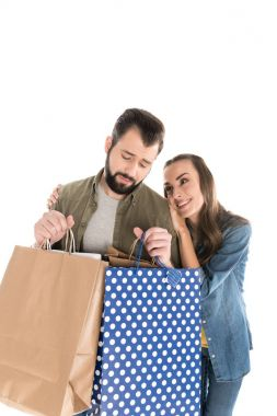 Couple with shopping bags, isolated on white stock vector
