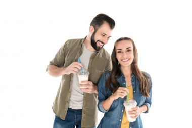 smiling couple with milkshakes
