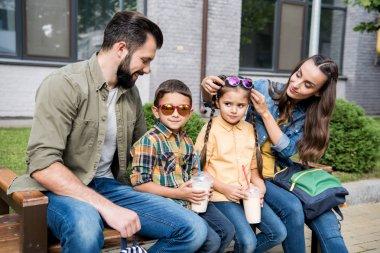 parents and children with milkshakes