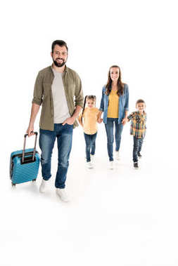 family with suitcase ready for journey