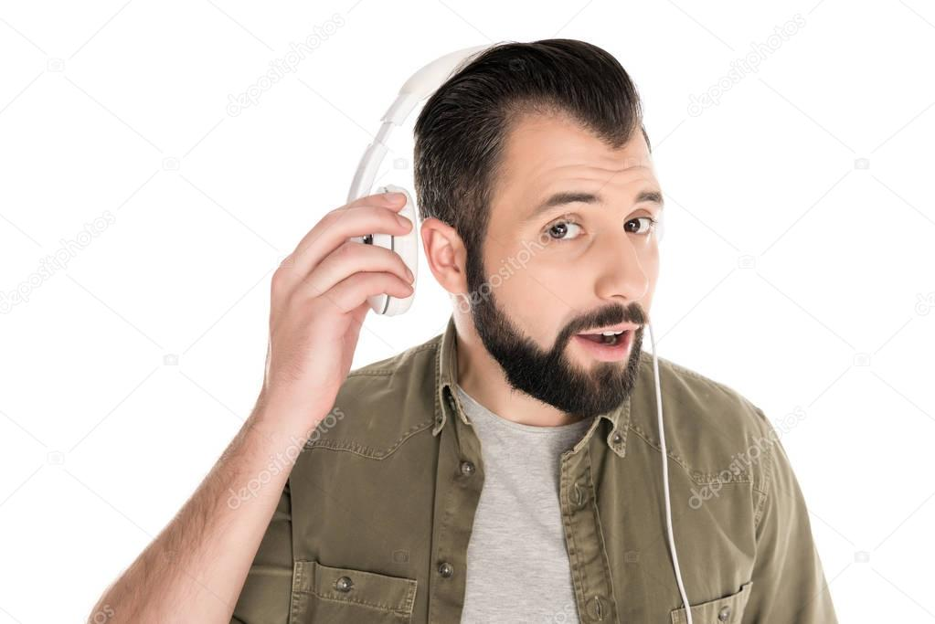 bearded man with headphones