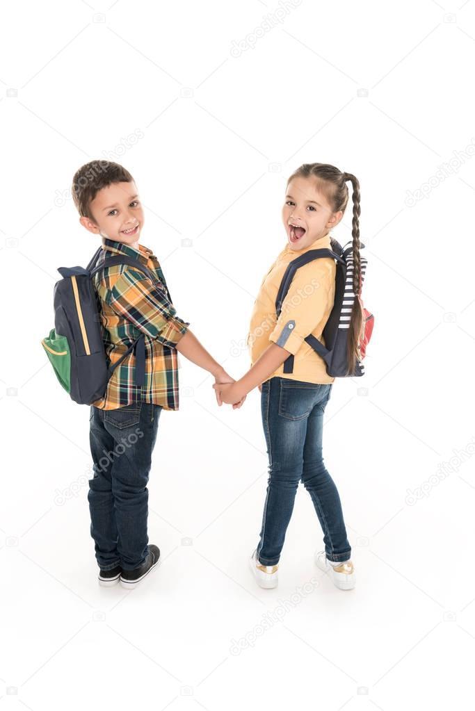 schoolchildren holding hands