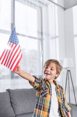 boy holding usa flag