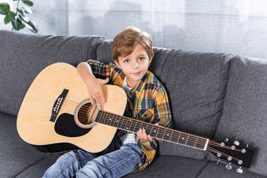 little boy with acoustic guitar