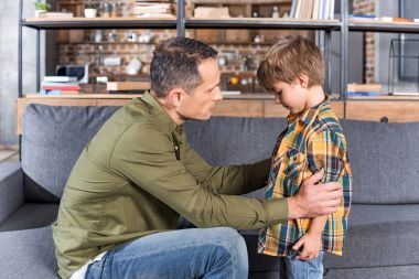 father talking to depressed son
