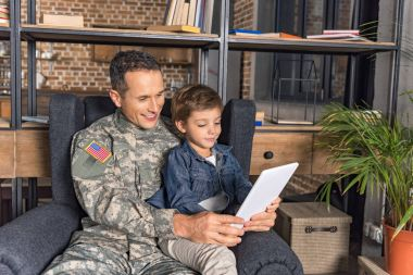 military father and son using tablet