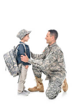 Father in camouflage uniform and son with backpack and cap isolated on white stock vector