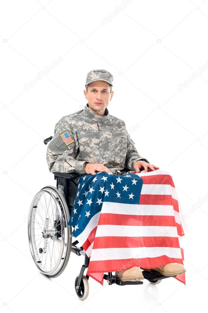 military man in wheelchair with usa flag