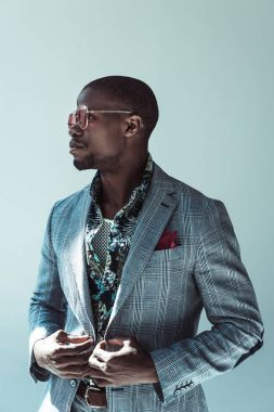 african american man in stylish suit and sunglasses