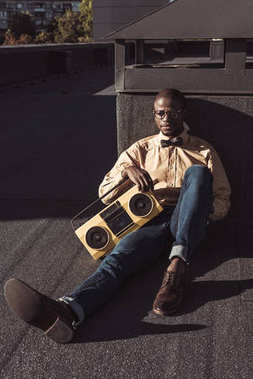man on floor with boombox