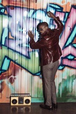 african american man painting graffiti