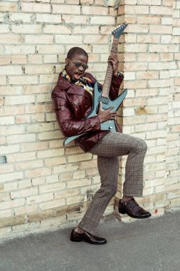 Handsome african american man playing guitar