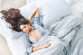 Fotografie young woman in lingerie on bed