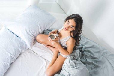 girl in lingerie drinking coffee