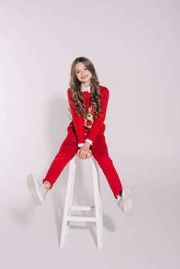 girl in red sweater with reindeer