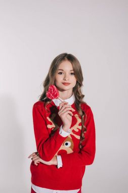 teenage girl holding candy