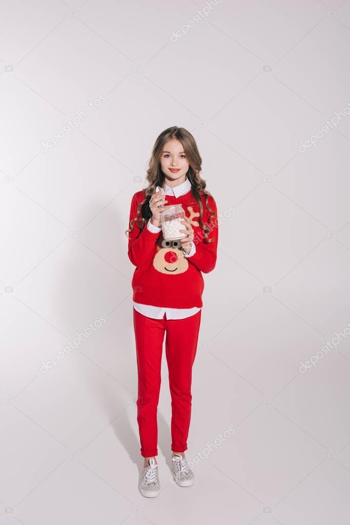 teenage girl holding marshmallows
