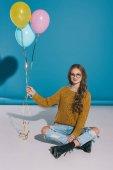 stylish teenage girl with balloons