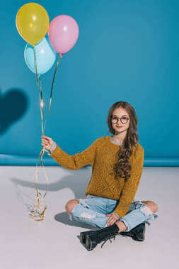 stylish teenage girl with balloons