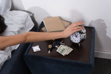 woman setting off alarm clock