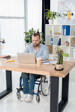 businessman on wheelchair working with laptop