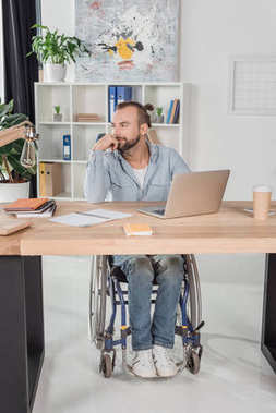 disabled man sitting at workplace