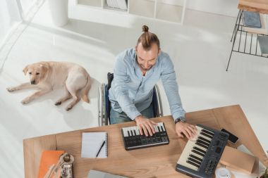 Disabled musician working with mpc pads