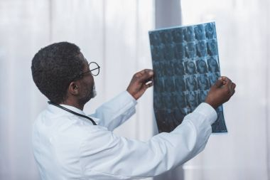 doctor looking at patient x-ray