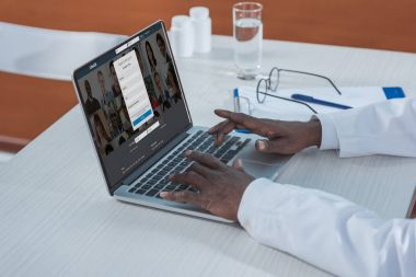 doctor with loaded LinkedIn website