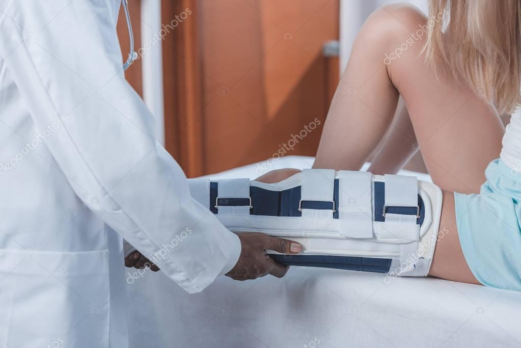 doctor examining patient leg