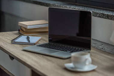laptop and notebook on table