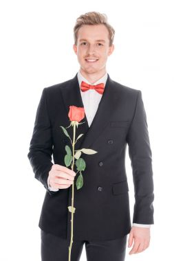 man in suit with rose flower