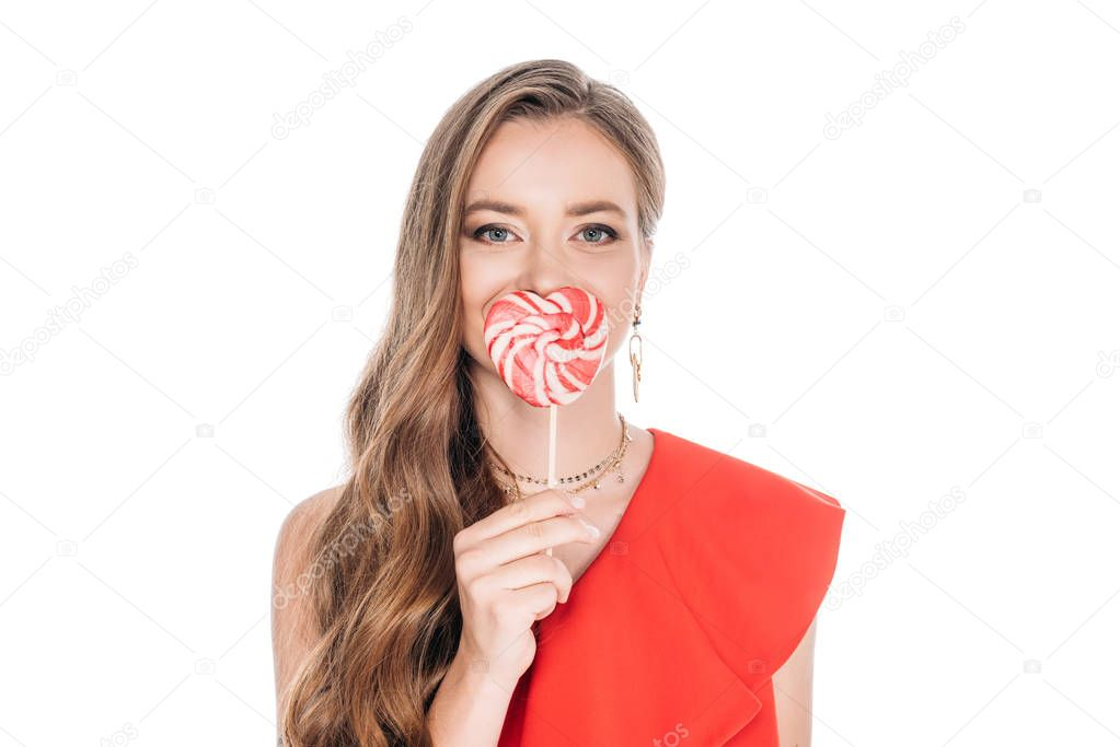 gorgeous woman with heart shaped lollipop