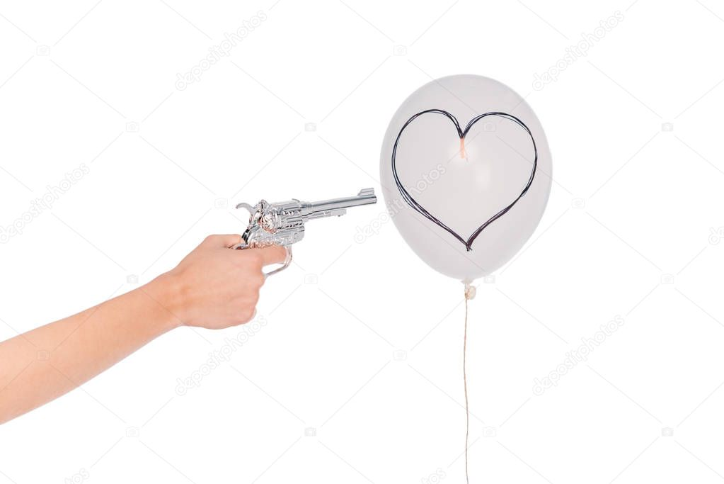 hand with revolver and balloon with heart