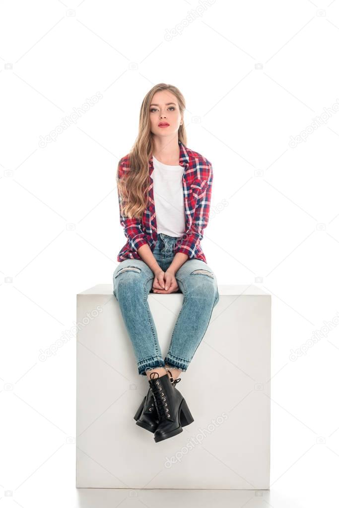 girl in checkered shirt and jeans