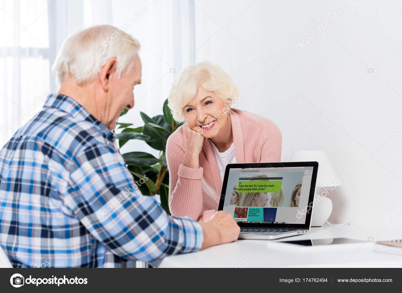 Awe Inspiring Portrait Senior Wife Looking Husband Using Laptop Bbc Logo Download Free Architecture Designs Scobabritishbridgeorg
