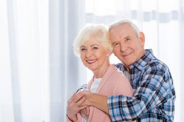 portrait of happy senior couple looking at camera
