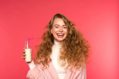 happy woman holding milkshake isolated on red