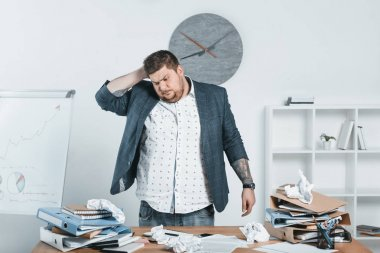 overweight businessman in suit working with documents in office