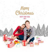 couple in winter sweaters with gifts