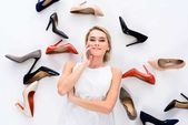 Photo beautiful girl posing with heeled shoes, isolated on white