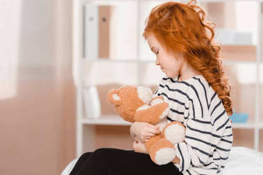 portrait of cute little girl with teddy bear