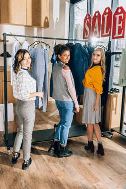 group of young women on shopping in clothing store