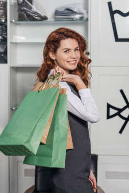 young woman with shopping bags at dry cleaning