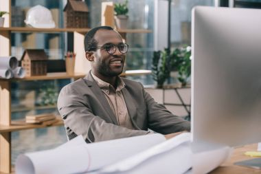 african american architect working  with computer
