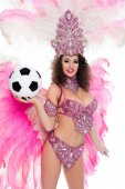 Photo woman in carnival costume holding football ball in hand, isolated on white